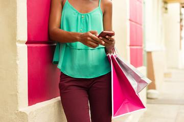 African American Girl Sending Text Messaging On Phone Shopping B