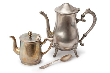 old coffee pots and silver spoon