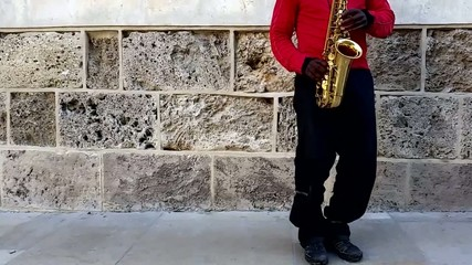 Playing the saxophone on the street