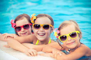 Happy children in the swimming pool