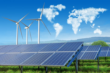 solar panels and wind turbines with world map in sky