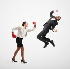 angry woman punching businessman