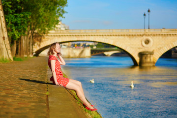 Beautiful young woman near the Seine in Paris