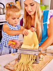 Mother and child making homemade pasta.
