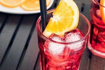 view of glasses of spritz aperitif aperol cocktail and ice