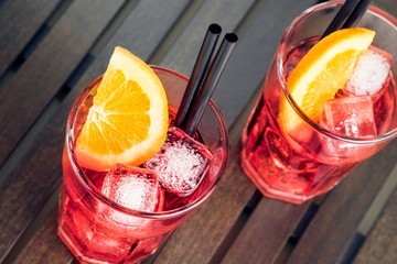 close-up of view of glasses of spritz aperitif red cocktail