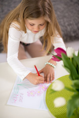 little girl making card for mother day
