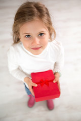 Cute little girl with gift