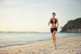 Fototapeta woman running seaside beach