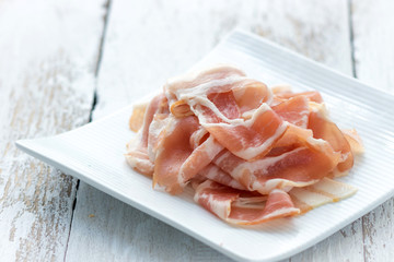 Fresh bacon on the wooden background