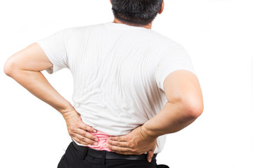 Man in white t-shirt suffering from lower back pain