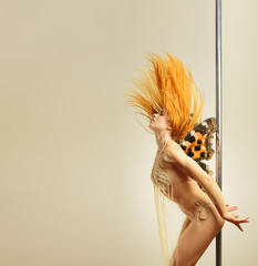 Winged pole dancer