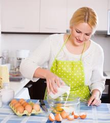 Girl making scrambled eggs