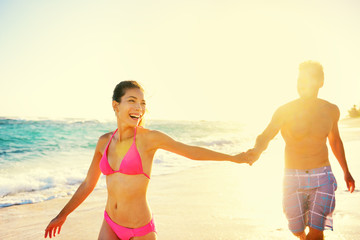 Laughing romantic couple summer vacation beach fun