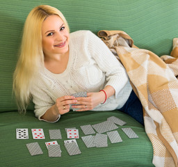 Blonde playing game of cards