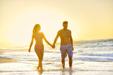 Honeymoon romantic couple in love at beach sunset