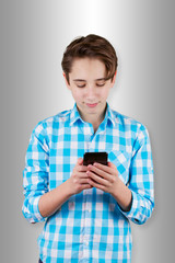 Teenager is typing  message in phone