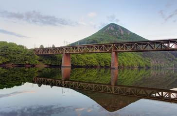 Lake with Mountain and railroad bridge
