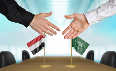 Yemen and Saudi Arabia diplomats agreeing on a deal