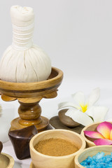 Spa massage setting with towels compress balls and herb
