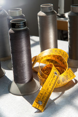 Tape measure and spools of yarn