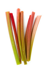 freshly cut stems of rhubarb isolated on white background