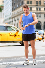 Runner looking at smart watch in New York City