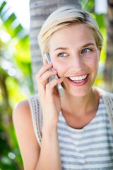 Pretty blonde woman calling on the phone