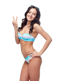 happy woman in swimsuit showing victory hand sign