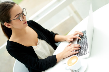 Young businesswoman using her laptop computer