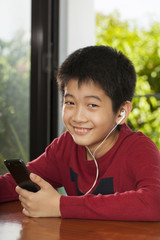 kid life, an Asian boy activity playing game on music player