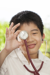kid life, an Asian boy playing with a doctor stethoscope