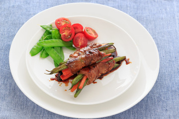 Vegetable wrapped by meat  with Teriyaki sauce