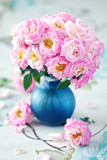 Beautiful fresh pink roses on a table.