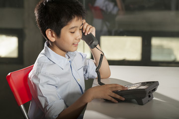 kid life, an Asian boy activity playing with telephone
