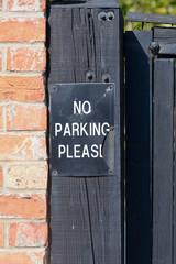 No Parking Please sign - broken