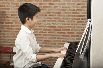 piano lesson, Asian boy kid activity playing piano with notes