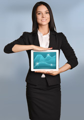 Young girl holding tablet with image of graphs financial