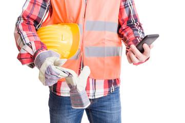 Modern builder checking smartphone