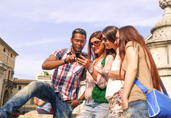 Happy group of students having fun with smartphone-Spring breack