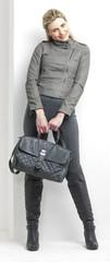 woman wearing grey clothes with a handbag