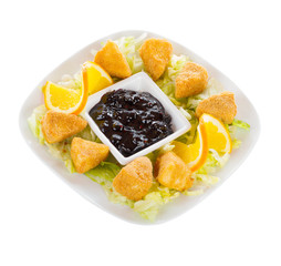 Fryed cheese in bread crumbs with blueberry jam
