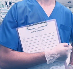 Medical worker whith clipboard in hospital room