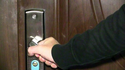opening door and hand with gun