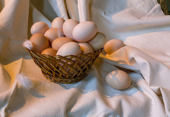 A straw small basket with eggs