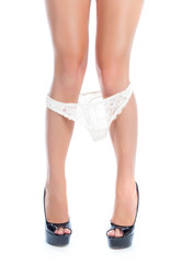 Female legs with white panties