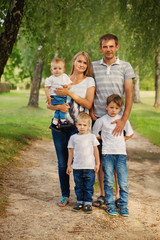 Portrait of a  family looking at the camera In Countryside