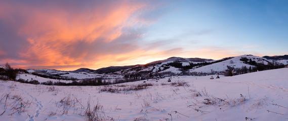Sunrise Carpathian mountain winter panorama.
