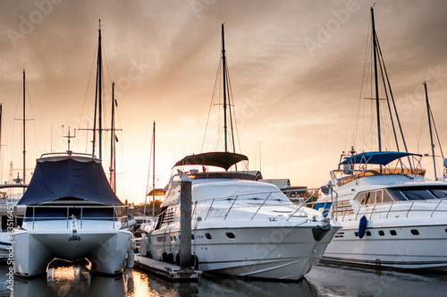 Plakat Yacht and boats at the marina in the evening