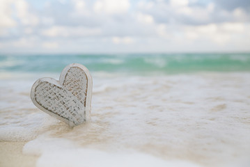 wooden heart in sea waves, live action ...